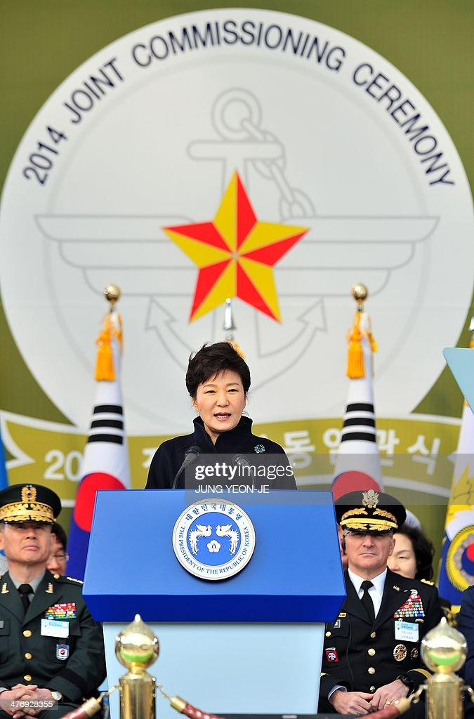 South Korean President Park Geun-Hye (C) speaks during the joint commission ceremony of 5,860 new military officers of the army, navy, air force and marines at the military headquarters in Gyeryong, south of Seoul, on March 6, 2014. Park urged North Korea to give up its nuclear program, saying denuclearization will pave the way for greater economic cooperation and ultimately unification between the two divided states. AFP PHOTO / POOL / JUNG YEON-JE