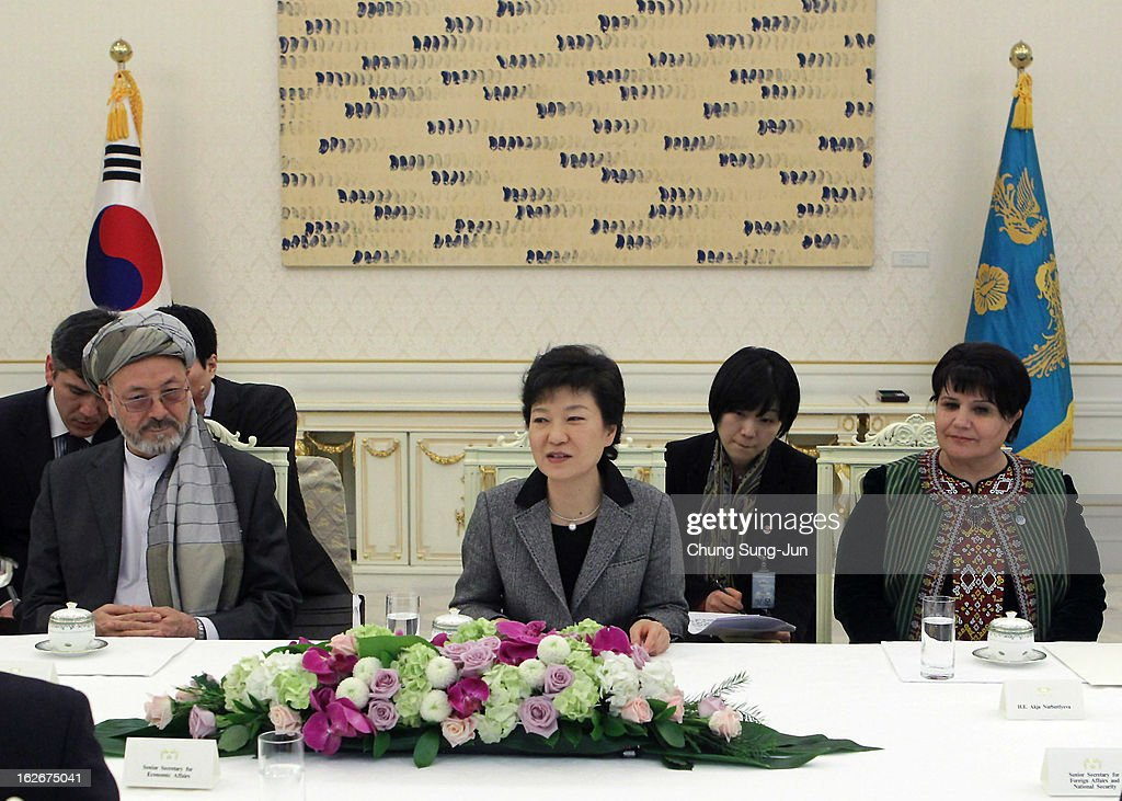 South Korean President Park Geun-Hye (C) talks with Akdja Nurberdiyeva (R), Turkmen Speaker of Parliament of Turkmenistan, and Karim Khalili, Vice President of Afghanistan, during their meeting at presidential house on February 26, 2013 in Seoul, South Korea. Park Geun-Hye, daughter of former president Park Chung-Hee, is the first female president of South Korea. Park engaged in a flurry of diplomacy on her second day in office, holding meetings with World leaders.