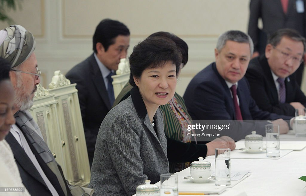 South Korean President Park Geun-Hye talks with guests during their meeting at presidential house on February 26, 2013 in Seoul, South Korea. Park Geun-Hye, daughter of former president Park Chung-Hee, the first female president of South Korea. Park engaged in a flurry of diplomacy on her second day in office, holding meetings with World leaders.