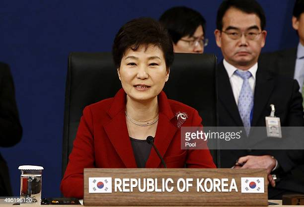 South Korean President Park GeunHye talks with Japanese Prime Minister Shinzo Abe and Chinese Prime Minister Li Keqiang during their trilateral...
