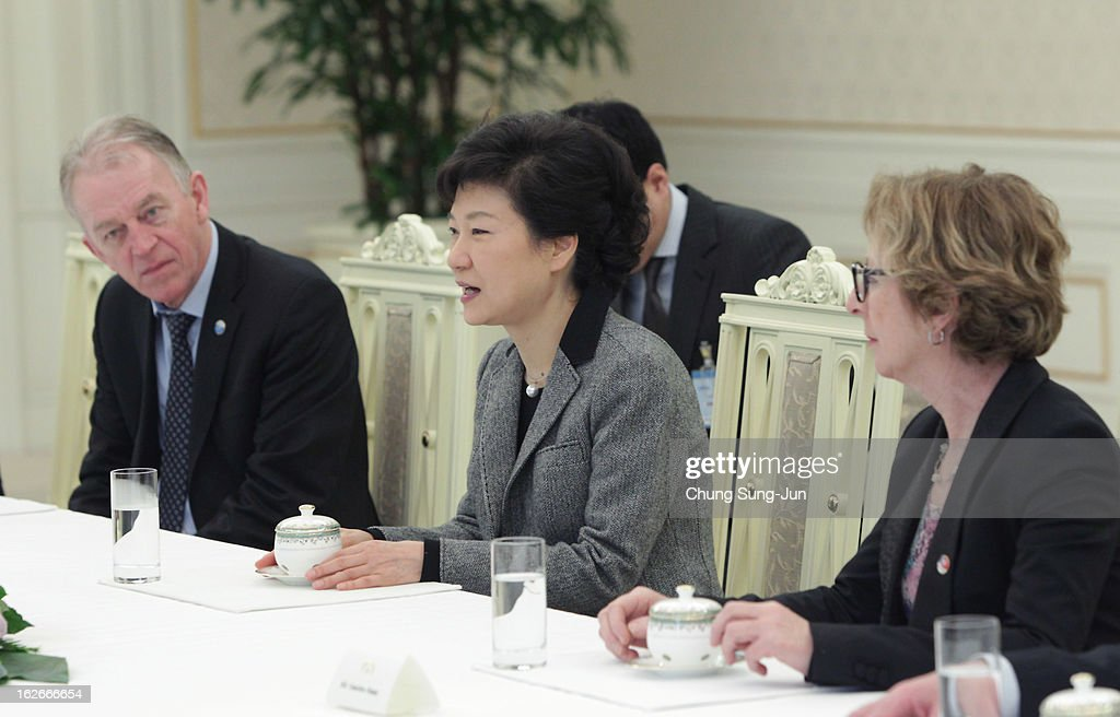 South Korean President Park Geun-Hye (C) talks with Villy Sovndal, Minister for Foreign Affairs of Denmark (L) and Genevieve Fioraso (R) Minister of Higher Education and Research of France during their meeting at presidential house on February 26, 2013 in Seoul, South Korea. Park Geun-Hye, daughter of former president Park Chung-Hee, the first female president of South Korea. Park engaged in a flurry of diplomacy on her second day in office, holding meetings with World leaders.