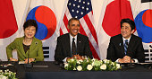 South Korean President Park Geunhye US President Barack Obama and Japanese Prime Minister Shinzo Abe attend their trilateral meeting on the sidelines...