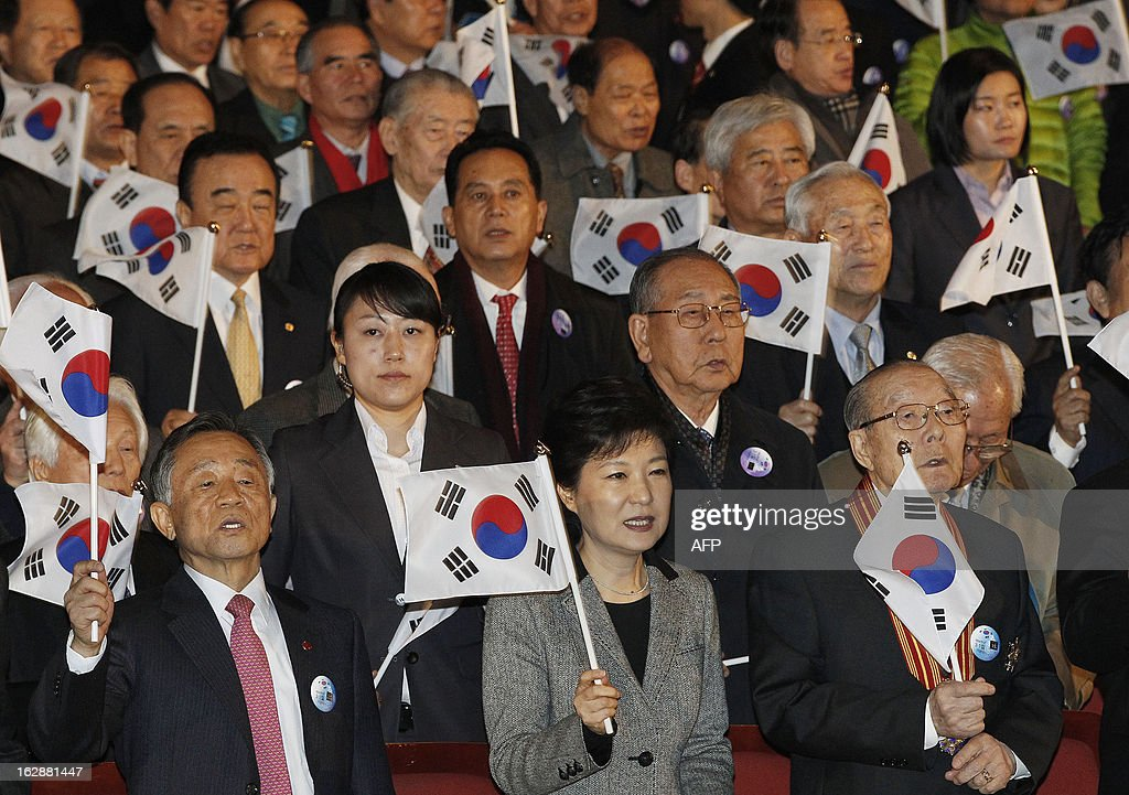 South Korean President Park Geun-hye (bottom C) waves a national flag during a ceremony to celebrate the March 1 Independence Movement Day, the anniversary of the 1919 uprising against Japanese colonial rule, in Seoul on March 1, 2013. South Koreans celebrate the public holiday of remembrance to mark the 1919 civilian uprising against Japanese colonial rule from 1910-1945.