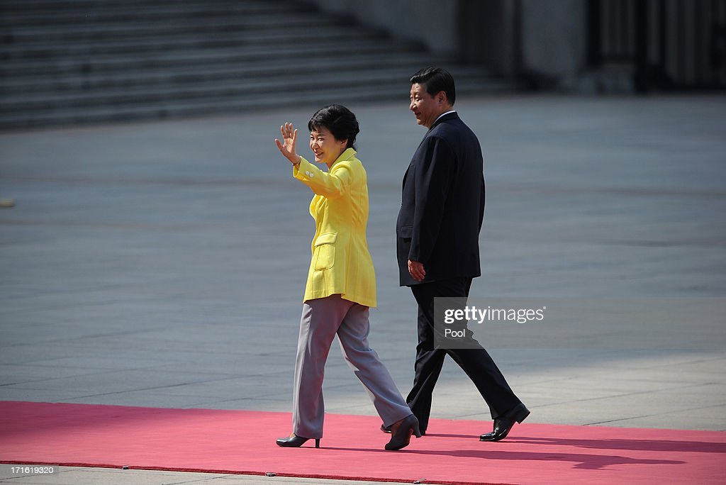 South Korean President Park Geun-Hye (L) waves as she and Chinese President Xi Jinping inspect Chinese honour guards during a welcoming ceremony outside the Great Hall of the People on June 27, 2013 in Beijing, China. Park Geun-Hye is visiting China from June 27 to 30.