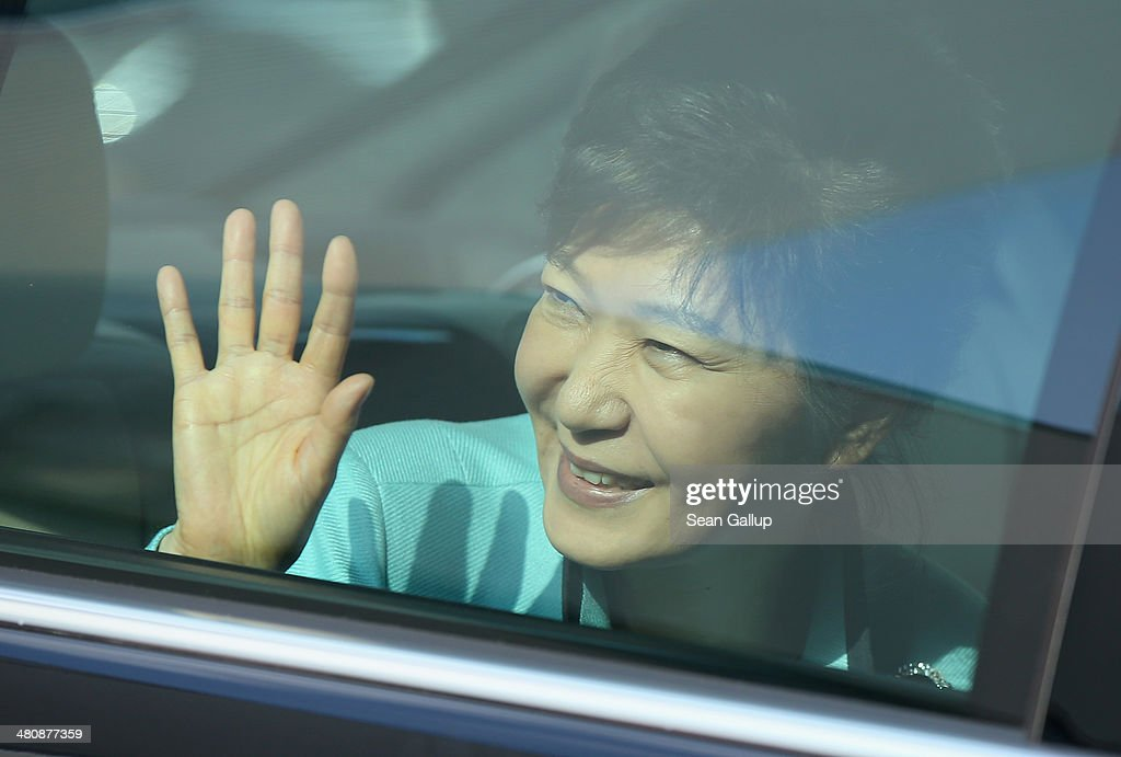 South Korean President <a gi-track='captionPersonalityLinkClicked' href=/galleries/search?phrase=Park+Geun-hye&family=editorial&specificpeople=603075 ng-click='$event.stopPropagation()'>Park Geun-hye</a> waves from her car as she departs after visiting the Siemens gas turbine factory on March 27, 2014 in Berlin, Germany. President <a gi-track='captionPersonalityLinkClicked' href=/galleries/search?phrase=Park+Geun-hye&family=editorial&specificpeople=603075 ng-click='$event.stopPropagation()'>Park Geun-hye</a> is on a two-day visit to the German capital.