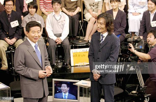 South Korean President Roh Moohyun speaks as guest Tsuyoshi Kusanagi a member of Japan's pop group SMAP listens during a TV program at TBS TV station...