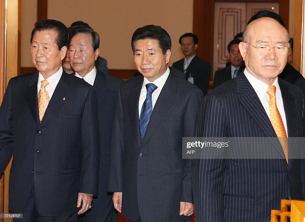 South Korean President Roh Moo-Hyun (C) walks into a room with his predecessors Kim Dae-Jung (L), Kim Young-Sam (2L) and Chun Doo-Hwan (R) before their luncheon to confer on North Korean issues at the presidential Blue House in Seoul, 10 October 2006. Roh is under fire over his 'sunshine' policy of engaging the North, met his predecessors over lunch to seek their views.