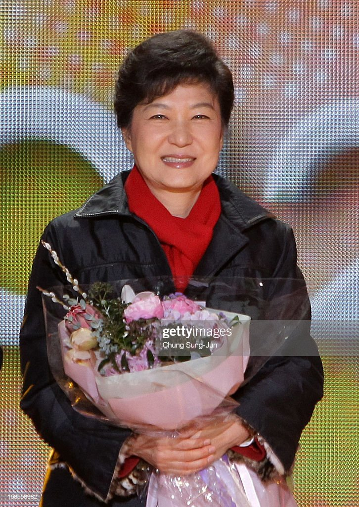 South Korean President-elect Park Geun-Hye, of the Ruling Saenuri Party holds flowers after she is declared the winner of the presidential elections on December 19, 2012 in Seoul, South Korea. Park, daughter of former president Park Chung-Hee, becomes the first female president of South Korea.