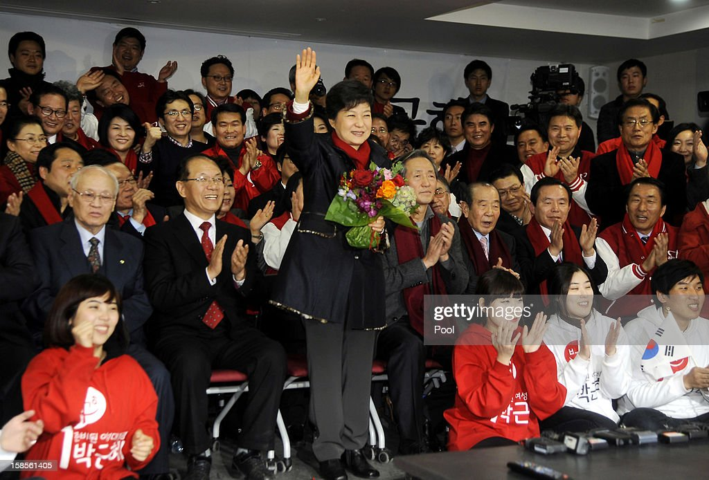 South Korean President-elect Park Geun-Hye, of the Ruling Saenuri Party celebrates with her party members during their applause after she is declared the winner of the presidential elections on December 19, 2012 in Seoul, South Korea. Park, daughter of former president Park Chung-Hee, becomes the first female president of South Korea.