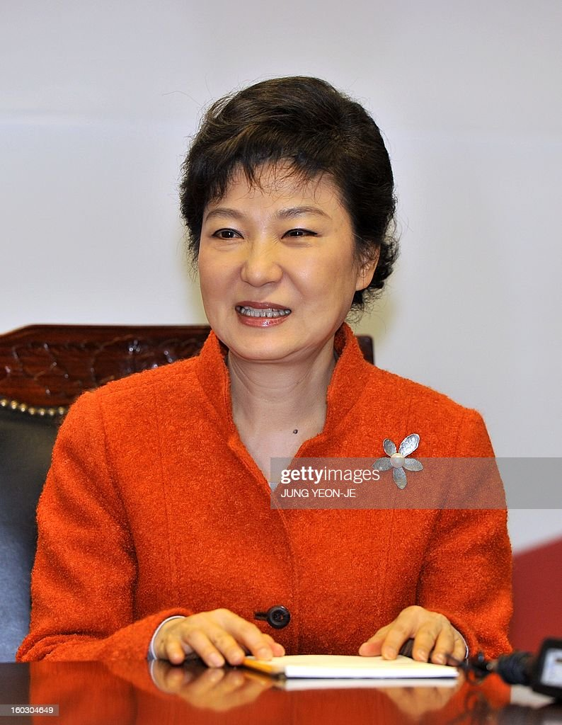 South Korean president-elect Park Geun-Hye talks during a meeting with Myanmar opposition leader Aung San Suu Kyi in Seoul on January 29, 2013. Suu Kyi arrived in South Korea on January 28 for a four-day visit including meetings with politicians and a soap-opera star and the collection of a human rights award.