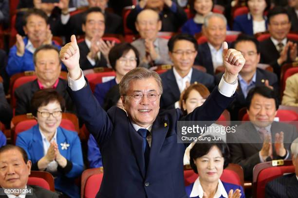 South Korean presidential candidate Moon Jaein of the Democratic Party of Korea reacts after a television report on an exit poll of the new president...