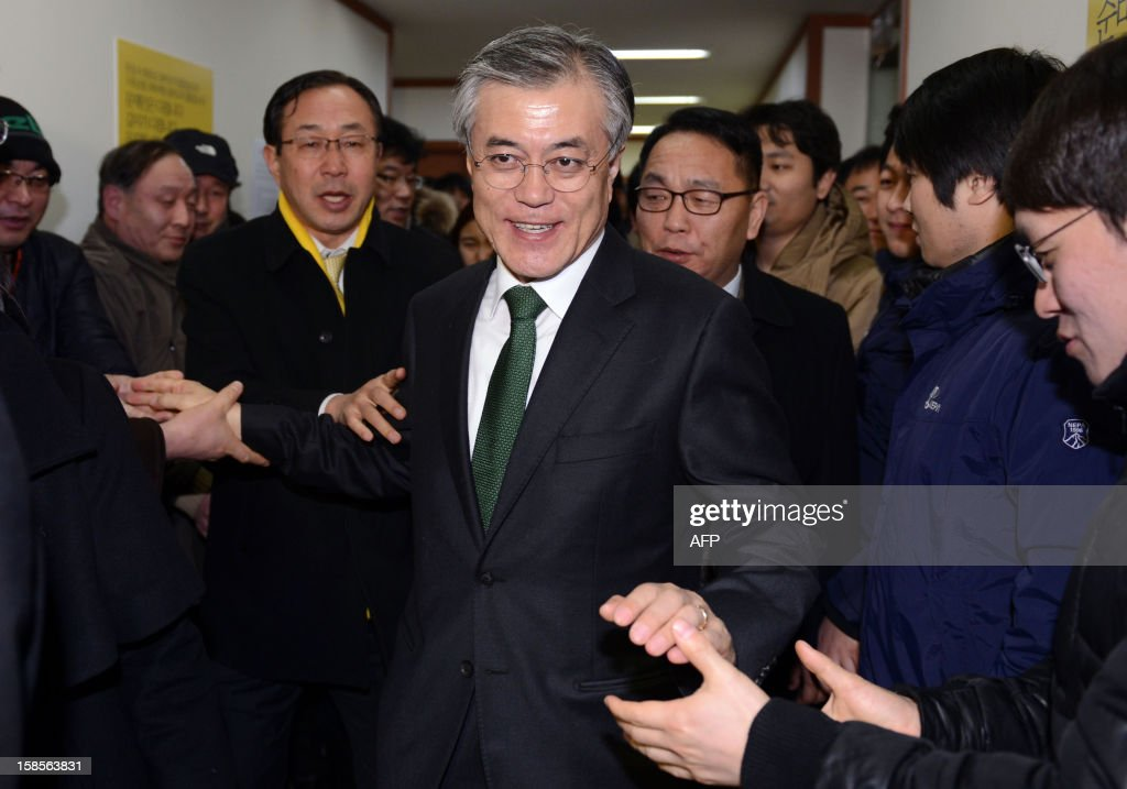 South Korean presidential candidate Moon Jae-In (C) of the main opposition Democratic United Party, leaves after a news conference declaring his rival's victory at the party headquarters in Seoul on December 19, 2012. South Korea elected its first female president on December 19, handing a slim but historic victory to conservative ruling party candidate Park Geun-Hye, daughter of the country's former military ruler. ILBO