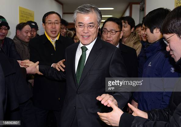 South Korean presidential candidate Moon JaeIn of the main opposition Democratic United Party leaves after a news conference declaring his rival's...