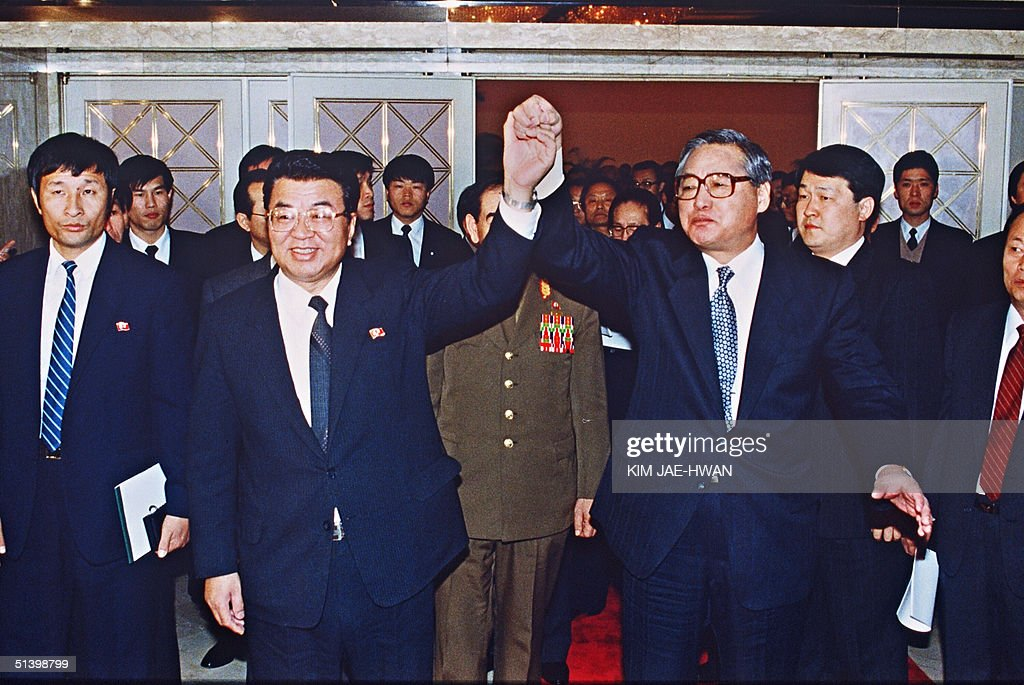 South Korean Prime Minister Chong Won-Shik (R) and his North Korean counterpart Yon Hyong-Muk join hands after signing a pact of reconciliation between their respective countries, 13 December 1991, in Seoul, to put an end to forty years of Cold War tensions on the Korean peninsula. The two Koreas agreed in principle to keeping the peninsula free of nuclear weapons.