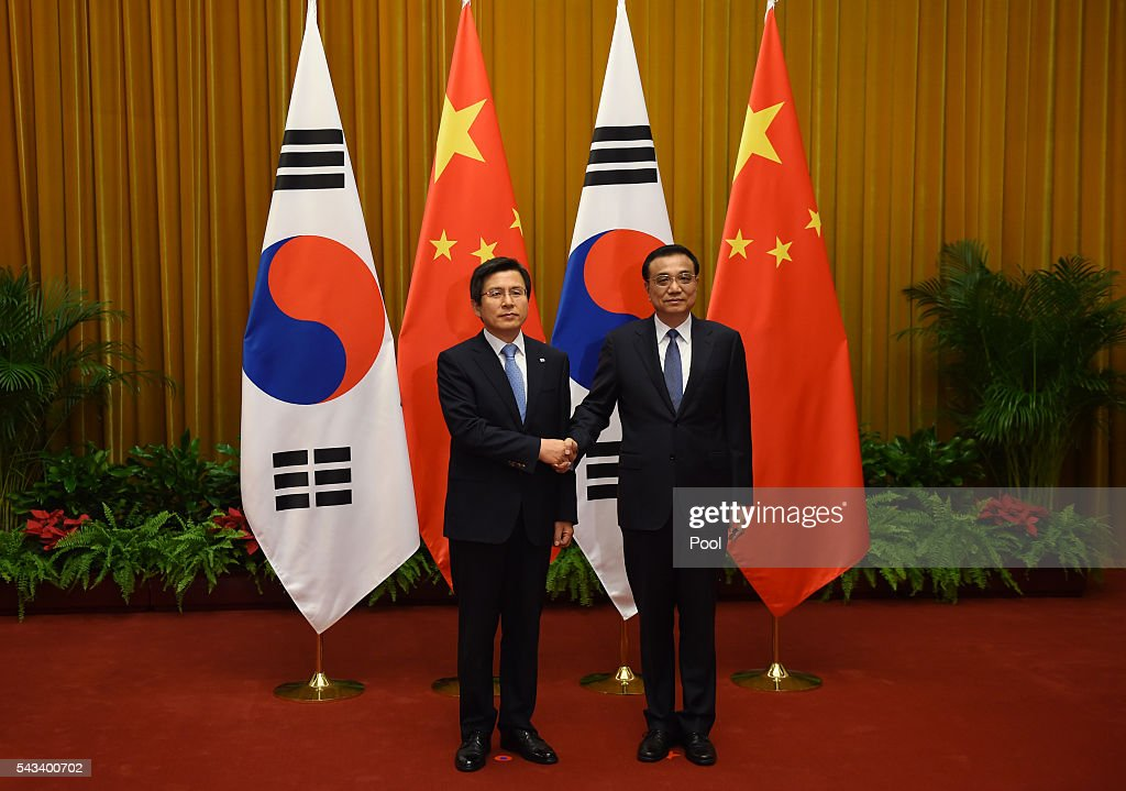 South Korean Prime Minister Hwang Kyo-ahn (L) is greeted by Chinese Premier <a gi-track='captionPersonalityLinkClicked' href=/galleries/search?phrase=Li+Keqiang&family=editorial&specificpeople=2481781 ng-click='$event.stopPropagation()'>Li Keqiang</a> in Beijing's Great Hall of the People on June 28, 2016 in Beijing, China.