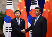 South Korean Prime Minister Hwang Kyoahn is greeted by Chinese President Xi Jinping before a meeting in the Great Hall of the People on June 29 2016...