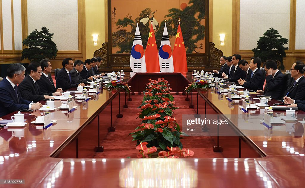South Korean Prime Minister Hwang Kyo-ahn (3rd R) meets with Chinese Premier <a gi-track='captionPersonalityLinkClicked' href=/galleries/search?phrase=Li+Keqiang&family=editorial&specificpeople=2481781 ng-click='$event.stopPropagation()'>Li Keqiang</a> (4th L) on June 28, 2016 in Beijing, China.