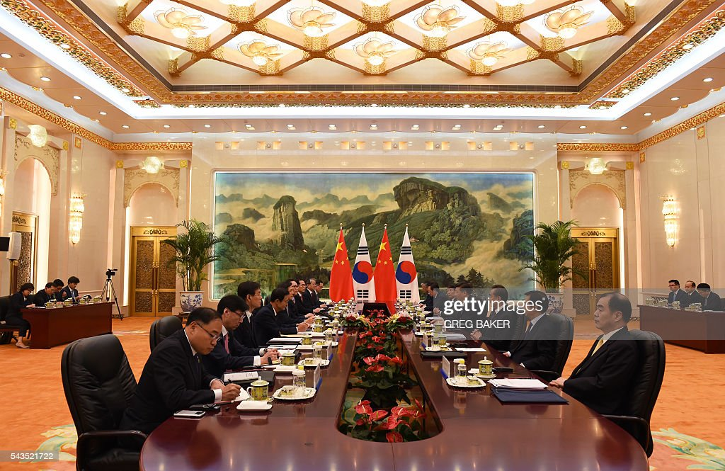 South Korean Prime Minister Hwang Kyo-ahn (5th L) meets with Chinese President Xi Jinping (4th R) at the Great Hall of the People in Beijing on June 29, 2016. / AFP / POOL / GREG