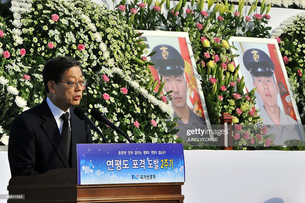 South Korean Prime Minister Kim Hwang-Sik (L) delivers a speech next to the portraits of marines Seo Jeong-Woo (C) and Moon Gwang-Wook (R) who were killed by North Korea's 2010 attack, during a ceremony to commemorate the second anniversary of North Korea's shelling of Yeonpyeong Island at the War Memorial in Seoul on November 23, 2012. The November 23, 2010 attack on Yeonpyeong island killed two South Korean marines and two civilians in one of the most serious border incidents since the 1950-1953 Korean War.