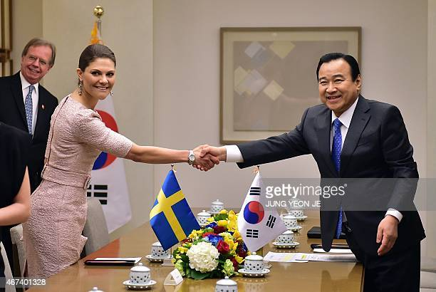 South Korean Prime Minister Lee WanKoo shakes hands with Swedish Crown Princess Victoria during their meeting at Lee's official residence in Seoul on...