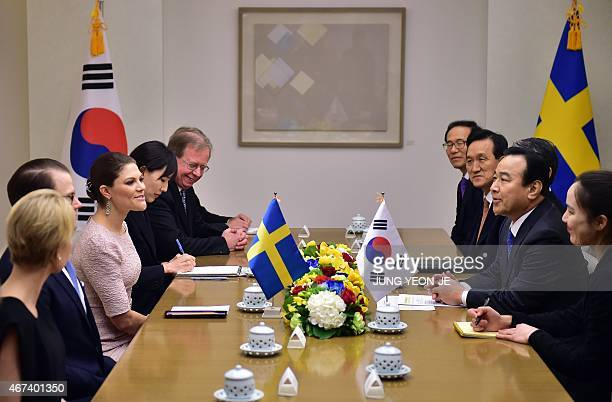 South Korean Prime Minister Lee WanKoo talks with Swedish Crown Princess Victoria during their meeting at Lee's official residence in Seoul on March...