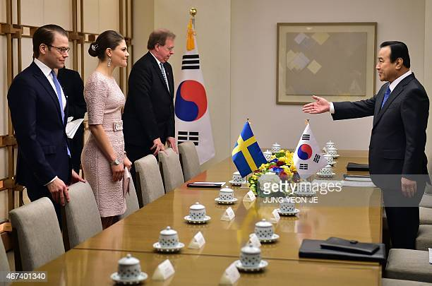 South Korean Prime Minister Lee WanKoo ushers Swedish Crown Princess Victoria during their meeting at Lee's official residence in Seoul on March 24...