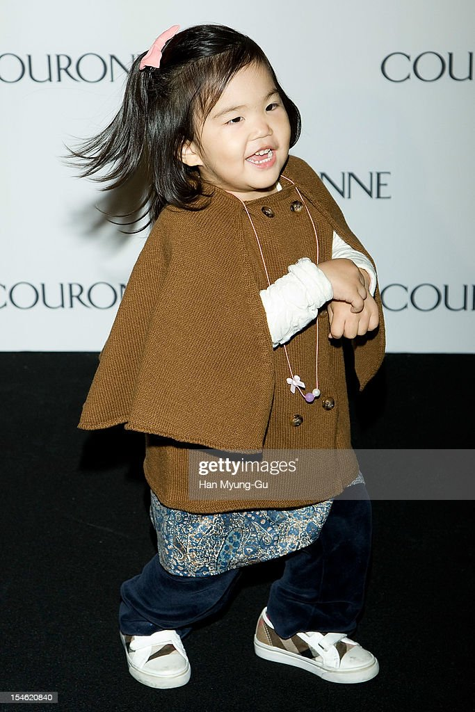 South Korean producer Joo Young-Hoon's daughter Joo A-Ra dances on as South Korean rapper Psy on the Promotional event of 'Couronne' Flagship Store Renewal Opening Party at Couronne Gangnam Store on October 23, 2012 in Seoul, South Korea.