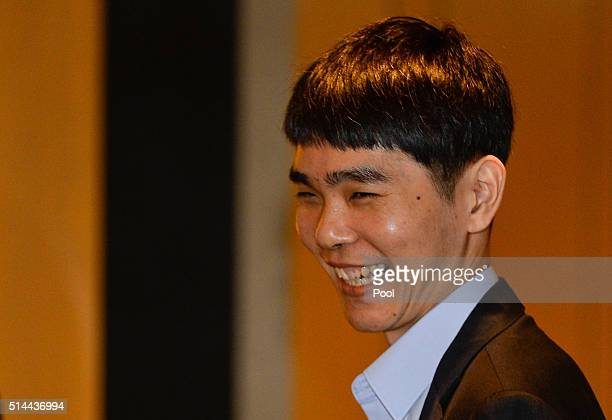 South Korean professional Go player Lee SeDol smiles before the match against Google's artificial intelligence program AlphaGo on March 9 2016 in...
