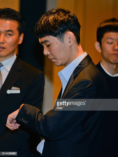 South Korean professional Go player Lee SeDol watches his clock before the match against Google's artificial intelligence program AlphaGo on March 9...