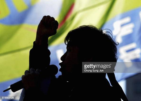 South Korean protester from a public service labor union shouts antigovernment slogans during a rally in front of the National Assembly on November 6...