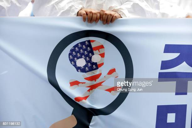South Korean protester hold antiUS placard at a rally against the deployment of the Terminal HighAltitude Area Defense near the US army base on...