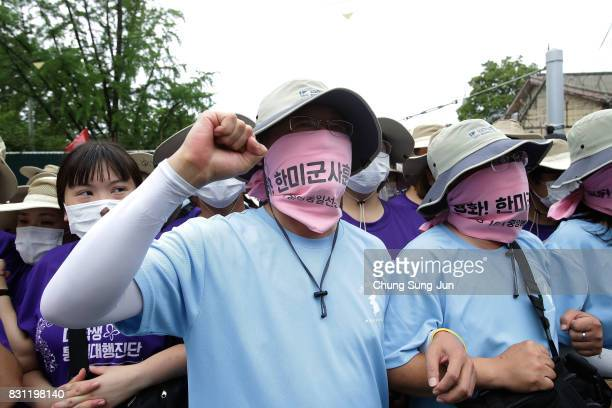 South Korean protesters attend the rally against the deployment of the Terminal HighAltitude Area Defense near the US army base on August 14 2017 in...