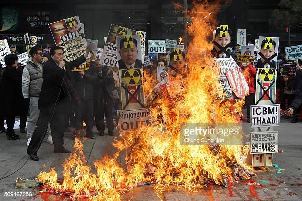 South Korean protesters burn an effigy of North Korea leader Kim JongUn during an antiNorth Korea rally on February 11 2016 in Seoul South Korea...