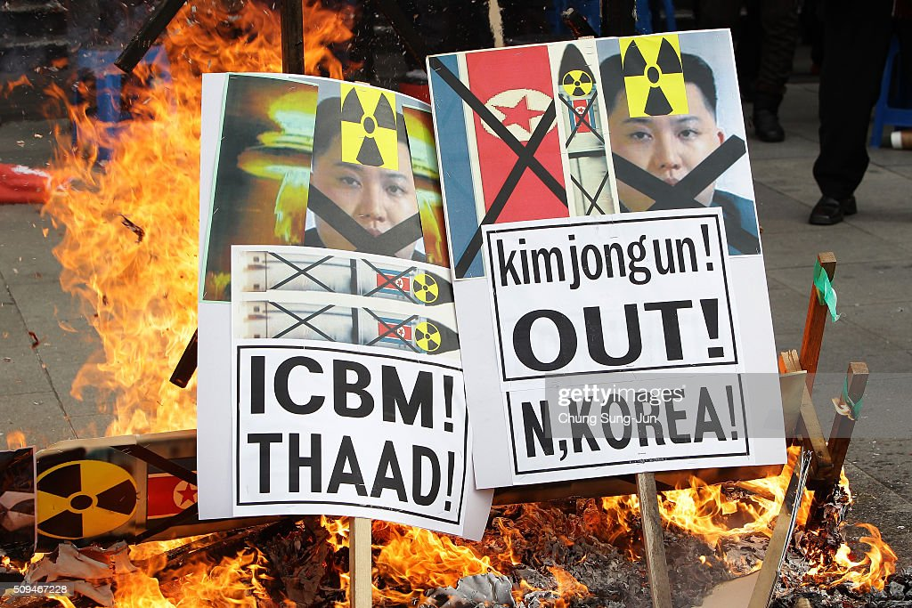 South Korean protesters burn an placards of North Korea leader Kim Jong-Un during an anti-North Korea rally on February 11, 2016 in Seoul, South Korea. South Korea announced on February 10, 2016 that the country would close an industrial complex jointly ran with North Korea, as the strongest response for North's recent nuclear test and rocket launch.