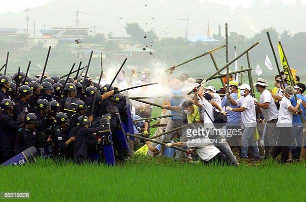 South Korean protesters crash with riot policemen near a US military base in Pyeongtaek 10 July 2005 during an antiUS rally opposing the relocation...