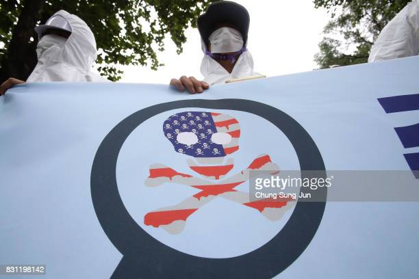 South Korean protesters hold antiUS placard at a rally against the deployment of the Terminal HighAltitude Area Defense near the US army base on...