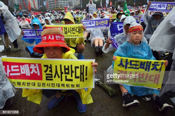 South Korean protesters hold banners reading 'No to deployment of the USbuilt Terminal High Altitude Area Defense antiballistic missile system'...