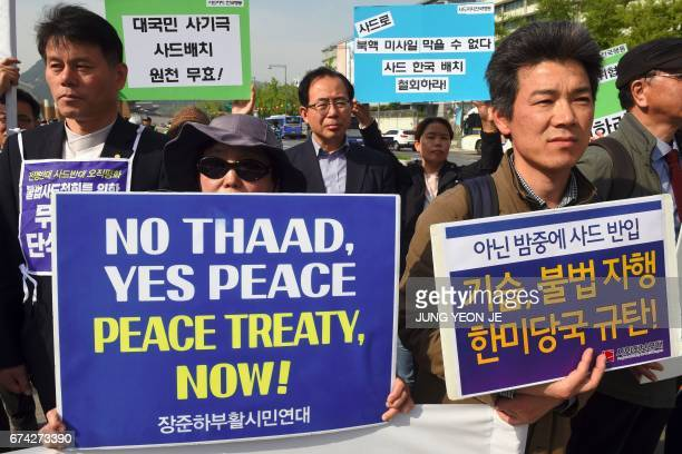 South Korean protesters hold placards during a rally against the deployment of the US Terminal High Altitude Area Defense system near the US embassy...