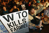 South Korean protesters including many farmers shout anti WTO slogans during a candlelight protest in memory of Lee KyungHae September 19 2003 in...