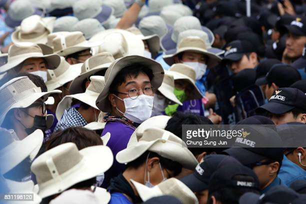 South Korean protesters scuffle with police during a rally against the deployment of the Terminal HighAltitude Area Defense near the US army base on...