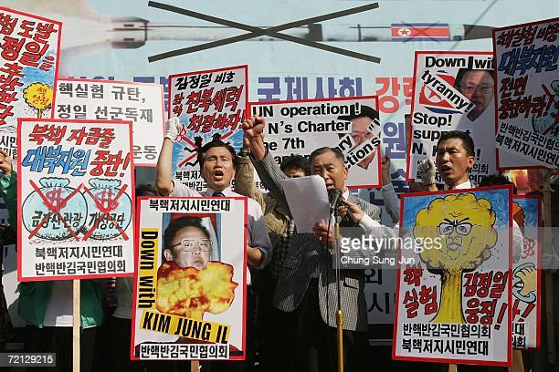 South Korean protesters shout slogans as they carry antiNorth Korea banners during a rally on October 10 2006 in Seoul South Korea North Korea is...