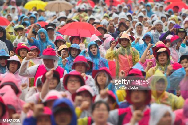 South Korean protesters shout slogans during an antiUS rally demanding peace in the Korean Peninsula in Seoul on August 15 2017 North Korean leader...