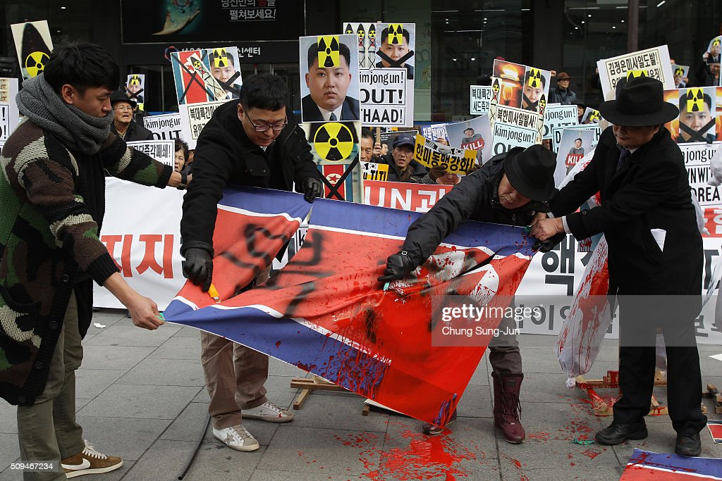 South Korean protesters tear North Korea's national flag with a knife during an anti-North Korea rally on February 11, 2016 in Seoul, South Korea. South Korea announced on February 10, 2016 that the country would close an industrial complex jointly ran with North Korea, as the strongest response for North's recent nuclear test and rocket launch.