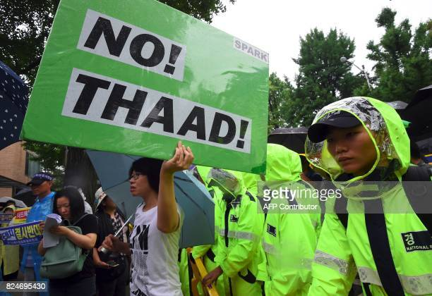 A South Korean protestor holds up a placard reading 'No THAAD' during a rally against the deployment of the US Terminal High Altitude Area Defense...