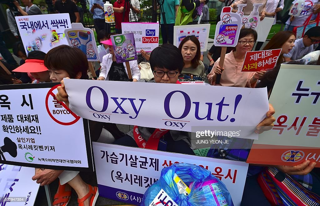 South Korean protestors hold banners during a campaign to boycott Reckitt Benckiser, whose Korean unit -- Oxy Reckitt Benckiser -- made humidifier disinfectants and sterilizers blamed for the deaths of more than 100 people in South Korea, outside the company's Seoul office in Seoul on May 31, 2016. Most of the victims were found to have used Oxy Ssak Ssak, a liquid humidifier disinfectant sold by Reckitt Benckiser in South Korea from 2001, that has been blamed for around 103 deaths -- mostly women and children. / AFP / JUNG