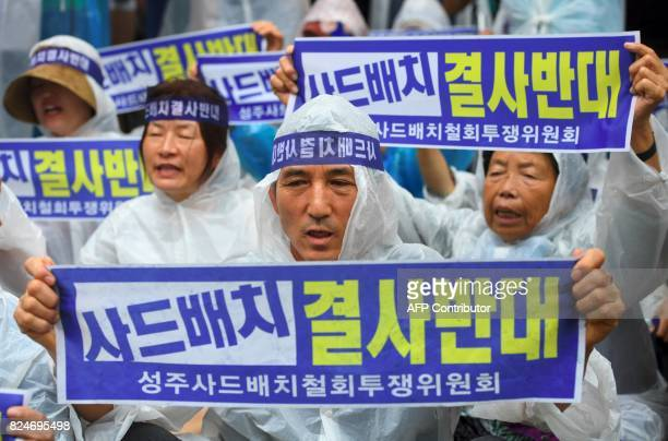 South Korean protestors hold banners during a rally against the deployment of the US Terminal High Altitude Area Defense system near the presidential...