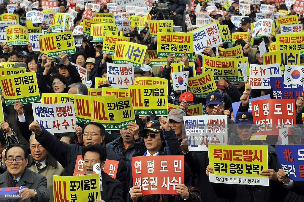 South Korean protestors hold placards reading 'Punish against North Korea's provocation!' during an anti-Pyongyang rally in Seoul on November 22, 2012, one day before the second anniversary of the shelling on Yeonpyeong island near the disputed Yellow Sea border. North Korea has threatened to repeat its 2010 artillery attack on a border island, as South Korea prepares to mark on November 23 the second anniversary of the shelling that left four dead.