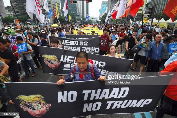 South Korean protestors march toward the US embassy during a rally against the deployment of the US Terminal High Altitude Area Defense system in...