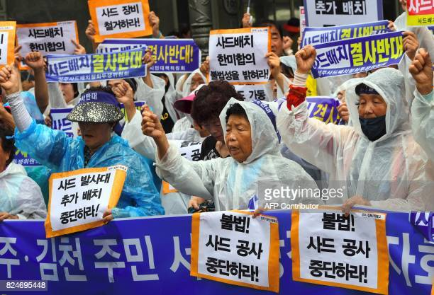 South Korean protestors shout slogans during a rally against the deployment of the US Terminal High Altitude Area Defense system near the...