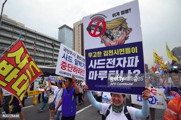 South Korean protestors surround the US embassy during a rally against the deployment of the US Terminal High Altitude Area Defense system in Seoul...